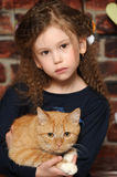 Girl with a red cat Royalty Free Stock Photos