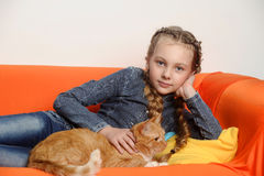 Girl with a red cat Royalty Free Stock Image