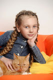 Girl with a red cat Royalty Free Stock Photo