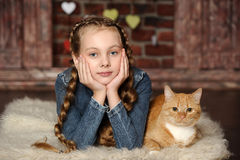 Girl with a red cat Stock Photography