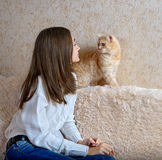 Girl and red cat Stock Images