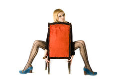 Girl and red chair Royalty Free Stock Image