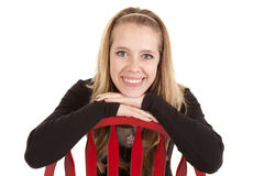 Girl red chair smile backwards Stock Image