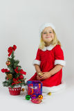 Girl in a red Christmas costume Royalty Free Stock Photography