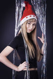Girl in a red Christmas hat Royalty Free Stock Photography