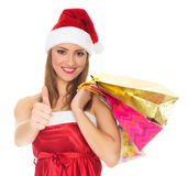 Girl in a red Christmas hat Stock Photos