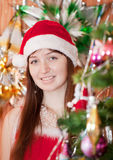 Girl in red Christmas hat stock photo
