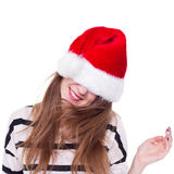 Girl in a red Christmas hat expressive shakes his head Stock Photo