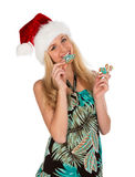Girl in red christmas hat holds gingerbread cookies in hand on w Royalty Free Stock Photos