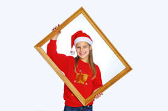 Girl in red christmas hats Stock Photos