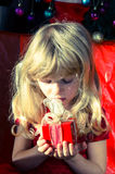 Girl with red christmas surprise box Royalty Free Stock Photography