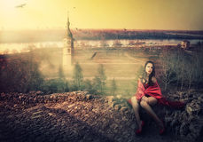 Girl in red cloak stock photo