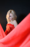 Girl in a red cloth Stock Photo