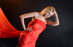 Girl in a red cloth Royalty Free Stock Photography