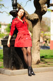Girl in a red coat. Royalty Free Stock Photos