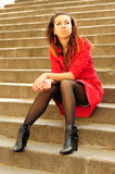 Girl in a red coat. Royalty Free Stock Photo