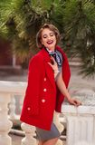 Girl in red coat laughs royalty free stock photos