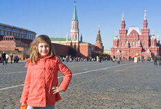 Girl in red coat on Red Square in Moscow Royalty Free Stock Photography