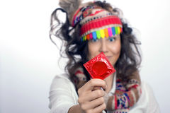 Girl with a red condom pack in the hand Stock Images