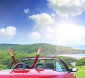 Girl in a red convertible car. Royalty Free Stock Photo