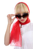 Girl in red correcting sunglasses Stock Photo