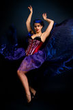Girl in a red corset on a dark background Stock Photography