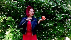 Girl with red hair dances, naughty, laughs, smiles, engaged with different subjects. Girl with red or crimson hair dances, naughty, laughs, smiles, engaged with stock footage