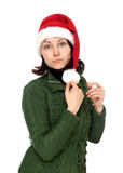 Girl in red cristmas hat Royalty Free Stock Image