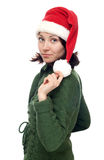 Girl in red cristmas hat Stock Image