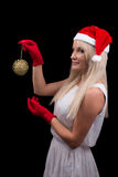 Girl in red Cristmas Santa hat Royalty Free Stock Photography