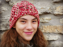 Girl with Red Crocheted Hat, Stone Wall Stock Photography