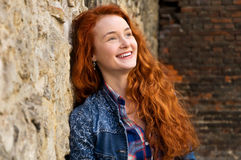 Girl with red curly hair. Hair burn like fire in the sun Stock Image