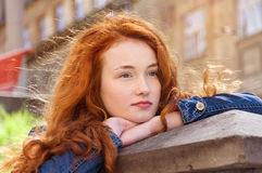 Girl with red curly hair. Hair burn like fire in the sun Royalty Free Stock Photos