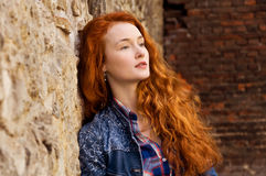 Girl with red curly hair. Hair burn like fire in the sun Royalty Free Stock Photo