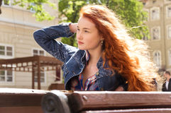 Girl with red curly hair. hair burn like fire in the sun Royalty Free Stock Photography