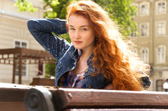 Girl with red curly hair. hair burn like fire in the sun Royalty Free Stock Image