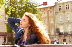 Girl with red curly hair. hair burn like fire in the sun Royalty Free Stock Images