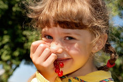 Girl with red currants Royalty Free Stock Photography
