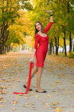 Girl in red dancing in the autumn mood Stock Photography