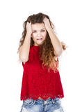 Girl in red desperation face. Woman in white background emotions and expressions Royalty Free Stock Photo