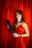 Girl in red with diploma  Royalty Free Stock Images