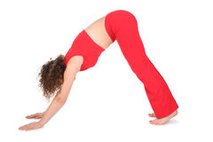 Girl in red doing yoga exercise Stock Image