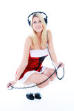 Girl in red dree in headphones Stock Images