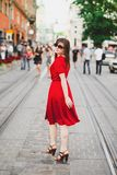 A girl in a red dres Stock Photos