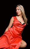A girl in a red dress. A white girl in a red dress on a black background stock image