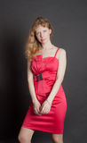 Girl in a red dress Stock Image