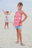 Girl in a red dress. On the shore Royalty Free Stock Photo
