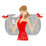 Girl in red dress. With a pair of shoes in her hands Royalty Free Stock Images