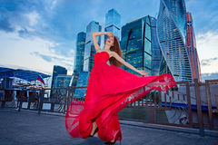 The girl in the red dress on the background of the Moscow-City . The concept of dance in the city Royalty Free Stock Image