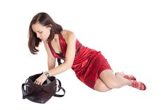 Girl in red dress with bag Royalty Free Stock Images